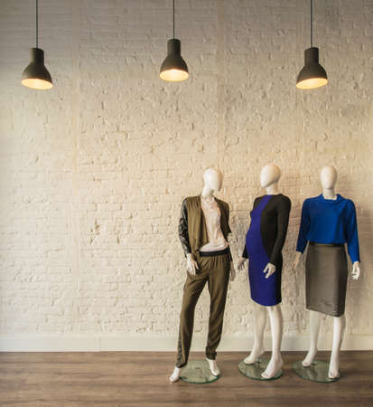 Interior of fashion clothing shop Imagens