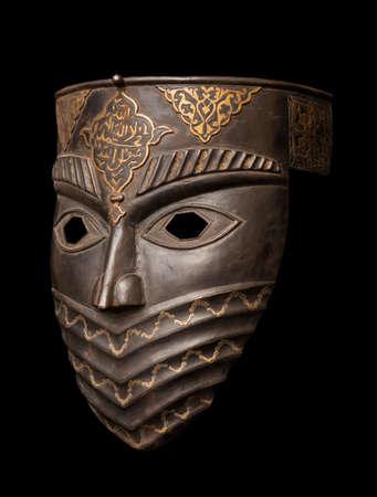 Metal mask isolated on black Stock Photo