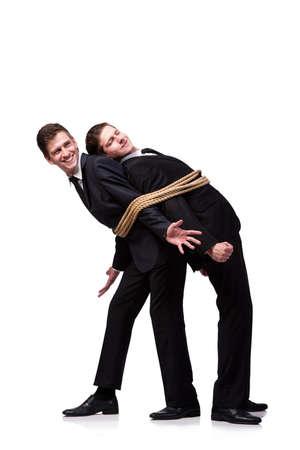 双子の兄弟、白で隔離にロープで縛られ 写真素材
