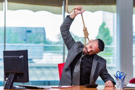 Concept of stressed businessman with noose around his neck