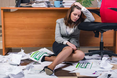 Businesswoman under stress working in the office Stock Photo - 60596311