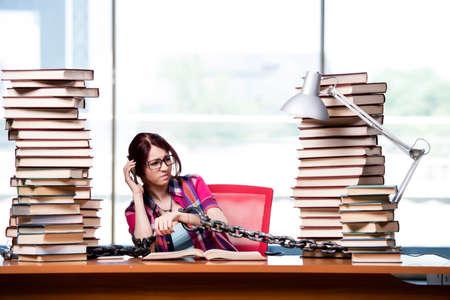 Young female student preparing for exams Banco de Imagens