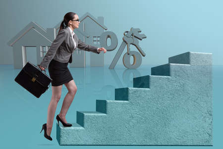 Businesswoman walking climbing stairs in mortgage Foto de archivo