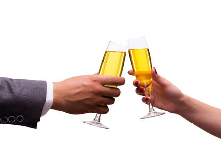 Hands with glasses of champagne isolated on white Stock Photo