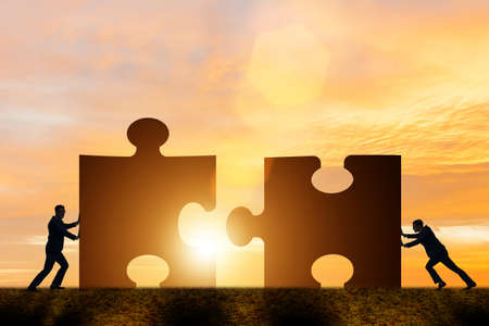 Business concept of teamwork with jigsaw puzzle Archivio Fotografico