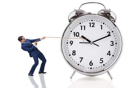 Businessman pulling clock in time concept