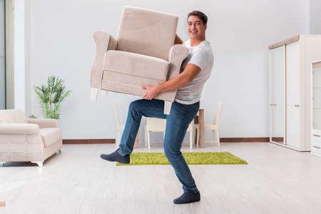 Man moving furniture at home Stock fotó
