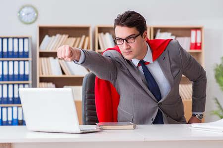 Superhero businessman working in the office 版權商用圖片