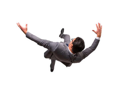 Falling businessman isolated on the white background Stock Photo - 69338917