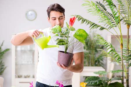 Man het verzorgen van planten in huis