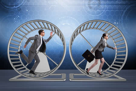 Business concept with pair running on hamster wheel Stock Photo - 70125692