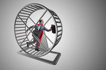 Geschäftsmann läuft auf Hamster Rad Standard-Bild - 70125726