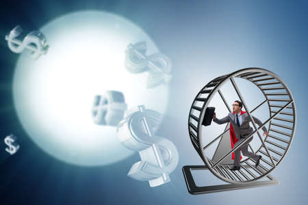 Business concept with businessman running on hamster wheel