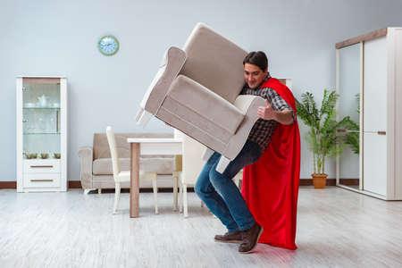 Super hero moving furniture at home