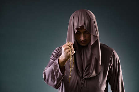 Monk in religious concept on gray background Stock Photo