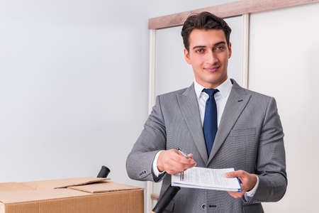 Man signing for the delivery of boxes Stock fotó