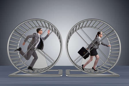Business concept with pair running on hamster wheel Фото со стока - 71199148