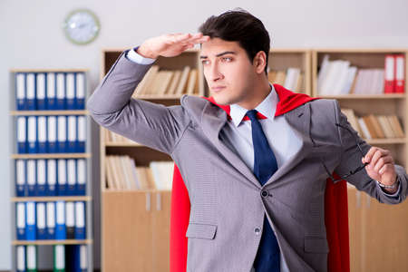 Superhero businessman working in the office Stock Photo