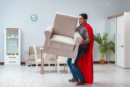 Super hero moving furniture at home