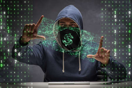 Hacker stealing dollars from bank Stock Photo