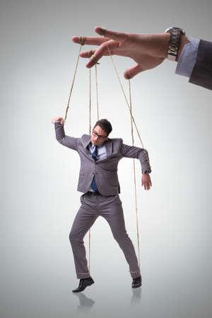 marioneta de negocios que es manipulado por el jefe Foto de archivo