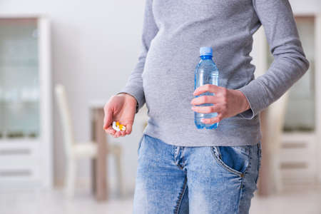 Pregnant woman taking pills during pregnancy