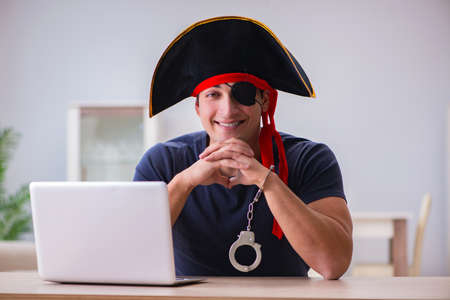 Digital security concept with pirate at computer