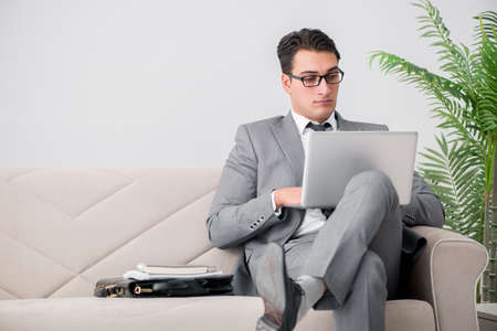 Businessman with laptop notebook sitting in sofa