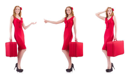 Young woman in red dress with suitcase isolated on white Stock Photo