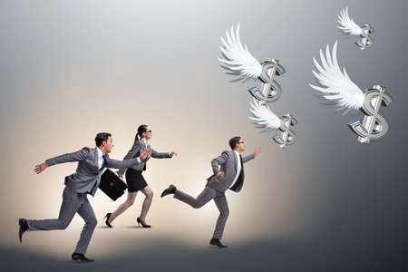 Businesspeople chasing angel investor funding Imagens