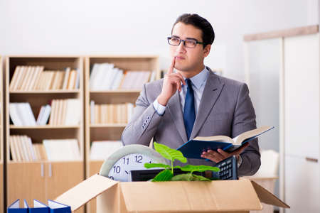 Young businessman moving offices after being made redundant Stock Photo