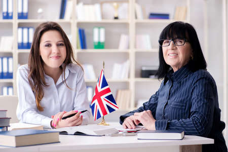 Young foreign student during english language lesson Stock Photo