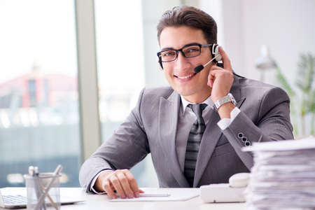 Helpdesk operator talking on phone in office Stock Photo - 75085198