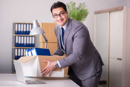 Young handsome businessman moving offices Stock Photo