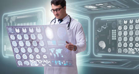 Male doctor studying results of brain mri scan Stock Photo