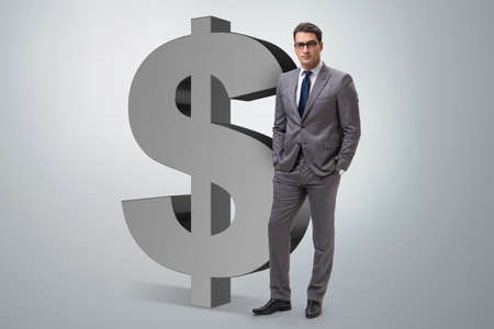 Businessman next to dollar sign