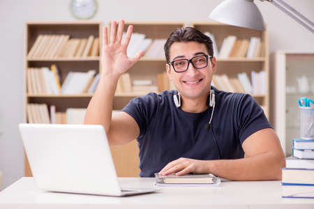 Young freelance worked working on computer Stock Photo