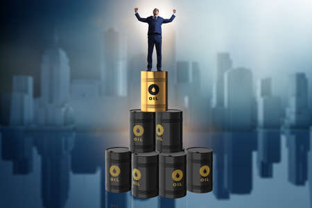 Businessman on top of oil barrels Reklamní fotografie - 76645209