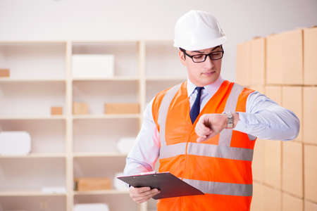 Man working in postal parcel delivery service office Stock Photo