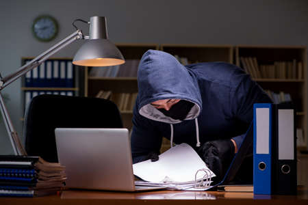 Hacker stealing personal data from home computer Stock Photo