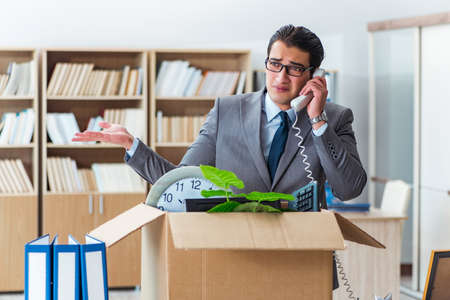 Man moving office with box and his belongings Stock Photo