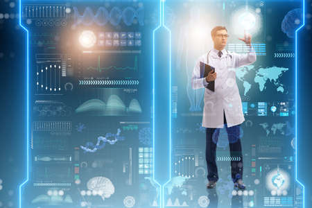 Doctor in futuristic medical concept pressing button Stock Photo