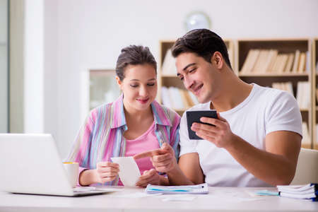 Young family discussing family finances Stock Photo - 77620919