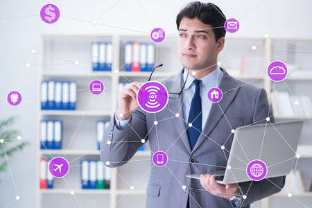 Internet of things concept with businessman Stock Photo