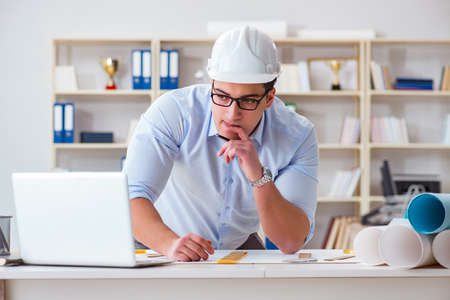 Male engineer working on drawings and blueprints Stock Photo