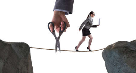Hand cutting the rope under businesswoman tightrope walker Stock Photo