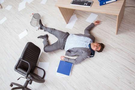Businessman dead on the office floor Stock Photo