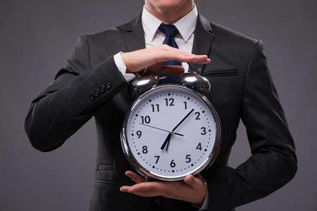 Businessman in time management concept Banco de Imagens