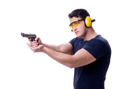 Man doing sport shooting from gun isolated on white Stock Photo
