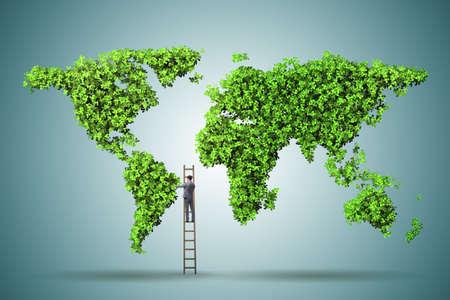 緑の環境コンセプトに梯子の上の実業家